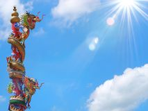 Chinese dragon statue climbing pole stock photo