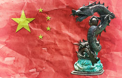 Chinese Dragon Statue On Chinese Flag. Royalty Free Stock Photo