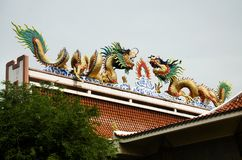 Chinese dragon Statue on roof of chinese temple in Wat Sakae Krang. Temple at Uthai Thani, Thailand Royalty Free Stock Image
