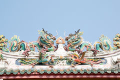 Chinese dragon statue on the roof Stock Photos