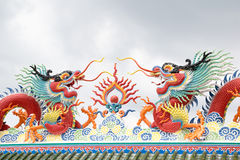 Chinese dragon statue on the roof with sky background Stock Photo