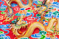 Chinese dragon statue  on temple wall in Thailand Stock Photo