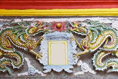 Chinese dragon wall China. Asian Chinese traditional dragon sculpture on wall with classic decorative design in ancient style in classical garden in China Asia royalty free stock photos