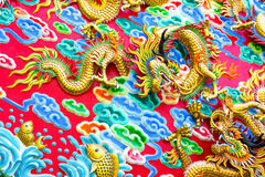 Chinese Dragon at the wall Stock Images