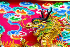 Chinese Dragon at the wall Stock Photos
