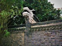 Chinese dragon and wall. Chinese details: dragon, wall and history royalty free stock images