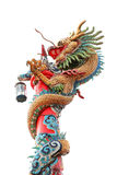 Chinese dragon wrapped around red pole on white Stock Photo