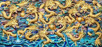 Chinese Dragons, Ancient Wood Sculpture in Chinese Temple. Ancient Wood Sculpture of 9 Shiny Golden Dragons in Chinese Temple, Kunming City, Yunnan, China Stock Photography