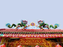 Chinese dragons. A pair of chinese dragons is  playing fired ball on a roof Stock Photo