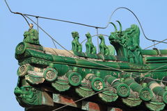 Chinese Dragons on a Roof Stock Photos
