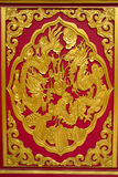 Chinese dragons sculpture. On the temple door royalty free stock photos