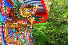 Chinese dragons statue on the wall. Royalty Free Stock Photo