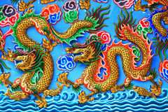 Chinese dragons statue on the wall. Stock Photos