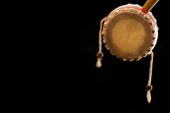 Chinese drum. Little chinese tambourine over black background, with a textspace Royalty Free Stock Photo