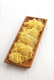 Chinese dry noodle in wooden dish Stock Image