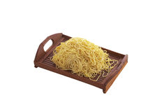 Chinese dry noodle in wooden dish. On white background Stock Photography