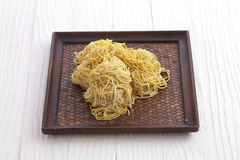 Chinese dry noodle in wooden dish. On white background Stock Image