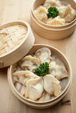 Chinese dumpling in a bamboo steamer box. On a wooden table Royalty Free Stock Photography