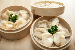 Chinese dumpling in a bamboo steamer box. On a wooden table Stock Photography
