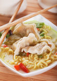 Chinese dumpling and noodle soup. Chinese dumpling and noodle vegetable soup with chopsticks Royalty Free Stock Image