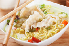 Chinese dumpling and noodle soup. Chinese dumpling and noodle vegetable soup with chopsticks Royalty Free Stock Photography