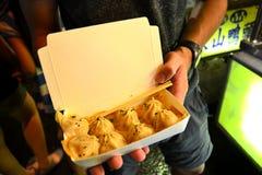 Chinese Dumpling in traveler hands Stock Image