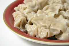 Chinese dumplings. On red plate Stock Photography