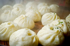 Chinese dumplings. Being steamed on the traditional bamboo pan Stock Image