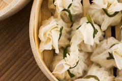 Chinese dumplings in bamboo steamers Stock Photos