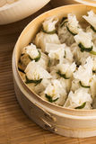 Chinese dumplings in bamboo steamers Stock Images
