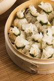 Chinese dumplings in bamboo steamers Stock Photo