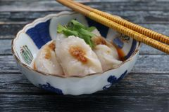 Chinese Dumplings Chai Pan. Chinese dumplings with chili sauce in vintage chinese ceramic bowl, on rustic wooden table Royalty Free Stock Photos
