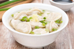 Chinese dumplings in chicken broth, close-up Stock Photography