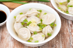 Chinese dumplings in chicken broth, top view Royalty Free Stock Photography