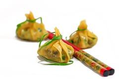 Chinese dumplings and chopsticks Royalty Free Stock Photo