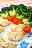 Chinese dumplings and vegetables Stock Photography