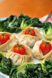 Chinese dumplings and vegetables Stock Photos