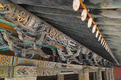 Chinese eave. The close-up of Chinese eave with colorized painting Royalty Free Stock Image