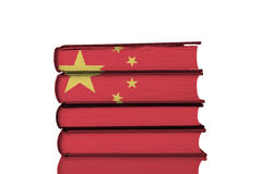 Chinese Education. Chinese Flag over Stack of Books, Isolated on a White Background .Chinese Education System Concept Stock Photo