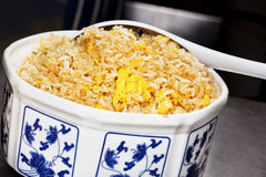 Chinese egg fried rice in porcelain bowl. Stock Photo