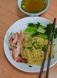 Chinese egg noodle with barbecue pork and soup Stock Photos