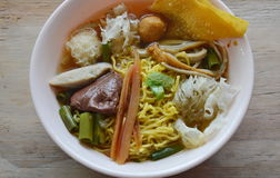 Chinese egg noodle with fish ball and crispy squid in soup Stock Photo