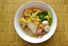 Chinese egg noodle topping fish ball and dumpling with Slice barbecue pork in soup Stock Photo