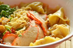 Chinese egg noodle topping slice barbecue pork and dumpling in soup Royalty Free Stock Image