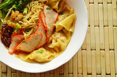 Chinese egg noodle topping slice barbecue pork and dumpling in soup Royalty Free Stock Photography