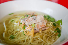 Chinese egg noodles with crab meat in hot soup. Stock Photo