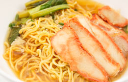 Chinese egg noodles with red pork in soup. Chinese egg noodles with red pork in hot soup Stock Images