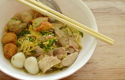 Chinese egg noodles topping fish ball and slice boiled pork in soup Stock Photos