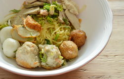 Chinese egg noodles topping shrimp ball and slice boiled pork on bowl Royalty Free Stock Photography