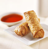 Chinese egg rolls with sauce on plate Royalty Free Stock Photo